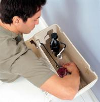 Plumber in Arlington TX working on an American Standard comfort height toilet